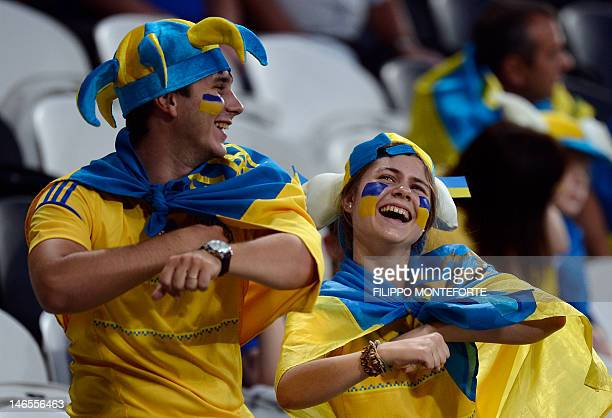 Ukrainian fans are pictured ahead of the Euro 2012 football championships match England vs Ukraine on June 19 2012 at the Donbass Arena in Donetsk...