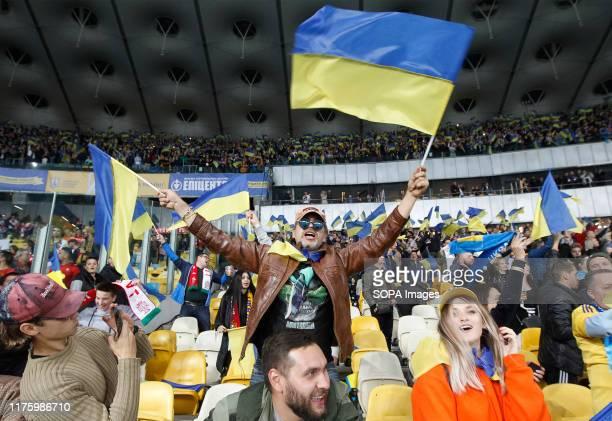 Ukrainian fans celebrate during the UEFA Euro 2020 qualifying, group B, football match between Portugal and Ukraine at the Olimpiyskiy stadium in...