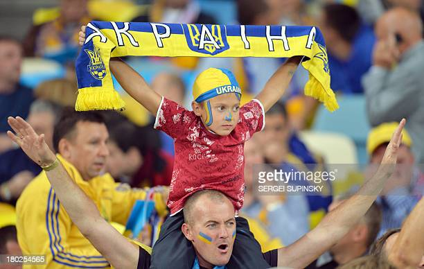 Ukrainian fans react during Brazil 2014 FIFA World Cup qualifiers Group H football match with England in Kiev on September 10 2013 The match enDed on...