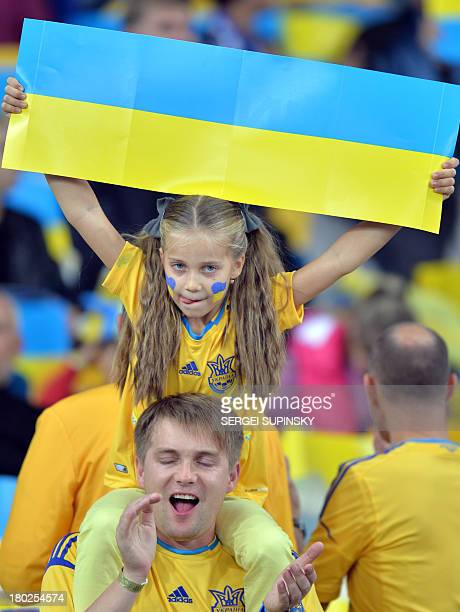 Ukrainian fans react during Brazil 2014 FIFA World Cup qualifiers Group H football match with England in Kiev on September 10 2013 The match ened on...