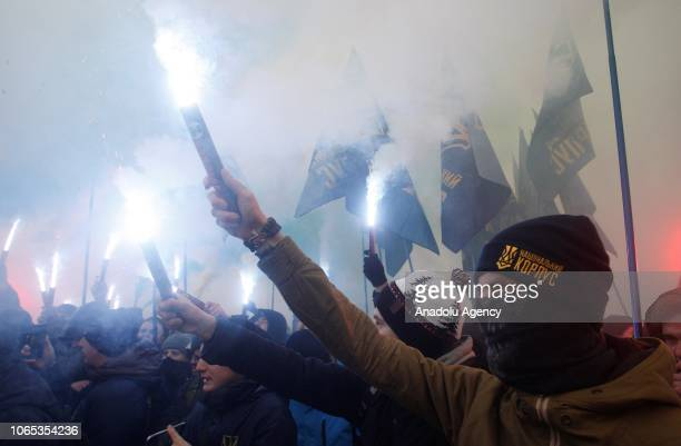 Ukrainian farright groups attend a rally as they burn flares demanding to set martial law in the country and to cut diplomatic relations with Russia...