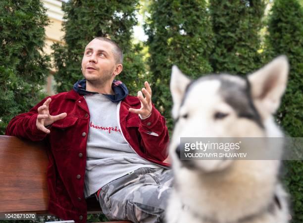 Ukrainian fashion designer Anton Belinskiy speaks during an interview with AFP in Kiev on September 18, 2018. - Anton Belinskiy who comes from the...