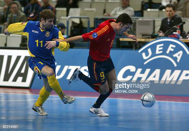 Ukrainian Fedir Pylipiv fights for the ball with Spain's Serrejon Sanchez during their semifinal indoor football match of the UEFA European Futsal...
