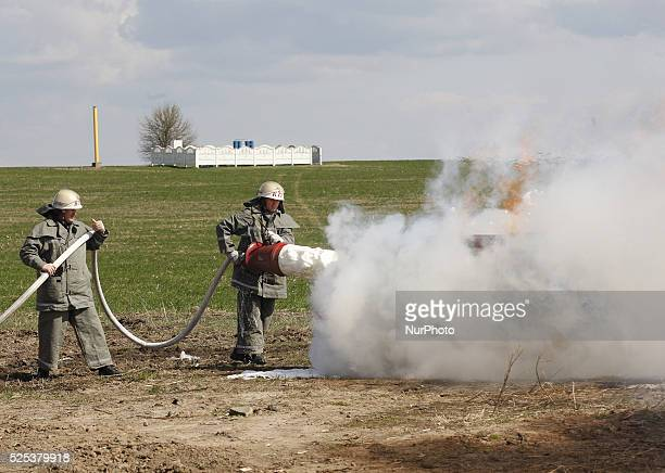 Ukrainian firemen use foam to extinguish a deliberate fire during an emergency training near the main natural gas pipeline at the gas-compressor...