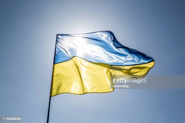 A Ukrainian flag flies at a political rally for Yulia Tymoshenko former Prime Minister not pictured in Kiev Ukraine on Friday March 29 2019 Ukraine...