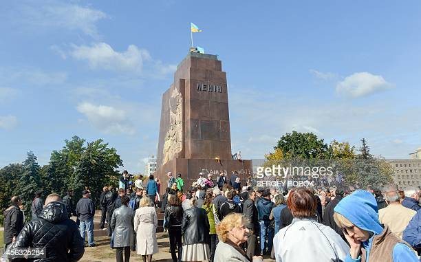 Ukrainian flags flutter in the place of a Lenin statue that was toppled by protesters the night before in Kharkiv on September 29 2014 Ukrainian...
