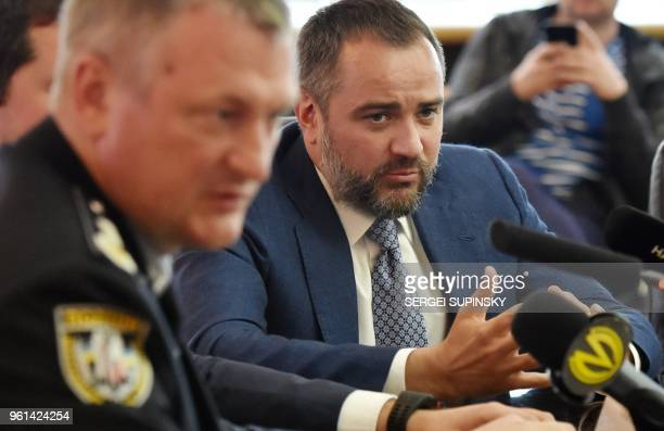 Ukrainian Football Federation head Andriy Pavelko listens as Head of Ukrainian National Police General Sergei Knyazev speaks during a press...
