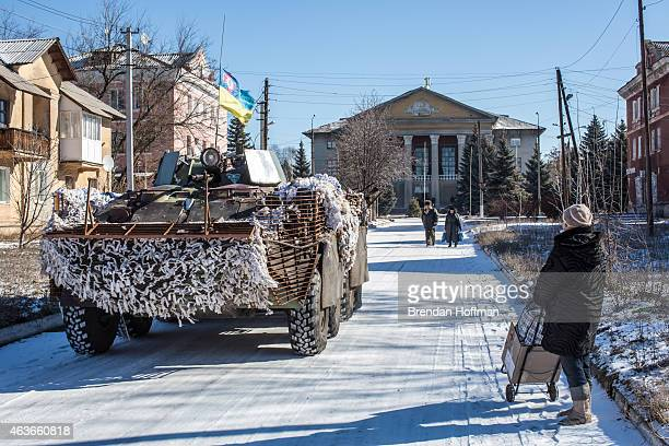 Ukrainian forces pass through the center of town on February 17 2015 in Myronivskyi Ukraine A ceasefire agreed to by Ukraine and proRussian rebel...