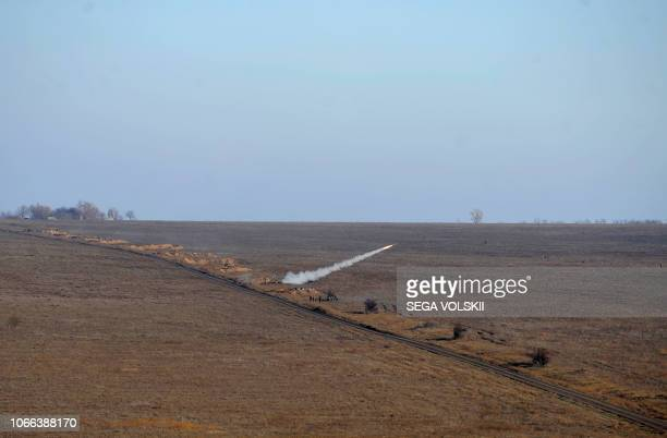 Ukrainian forces shoot a rocket during military drills near Urzuf village not far from the city of Mariupol eastern Ukraine on November 29 2018...