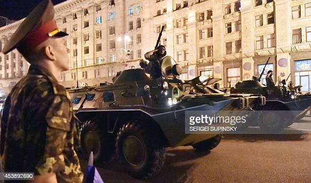 Ukrainian forces stand on armoured personnel carriers on August 20 2014 in the center of Kiev during a rehearsal ahead of the Ukraine's Independence...