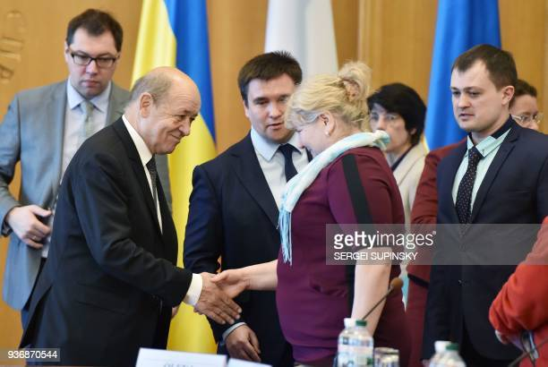 Ukrainian Foreign Affair Minister Pavlo Klimkin and his French counterpart JeanYves Le Drian talk with the relatives of Ukrainian political prisoners...