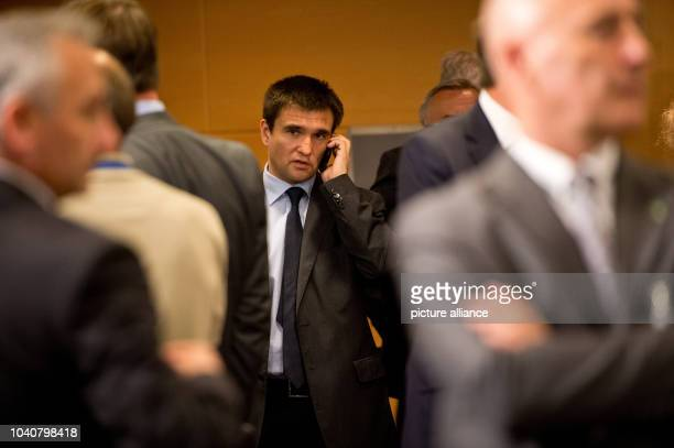 Ukrainian Foreign minister Pawel Klimkin talks on the phone at the NATO Foreign ministers meeting in Brussels in Brussels Belgium 25 June 2014 Last...