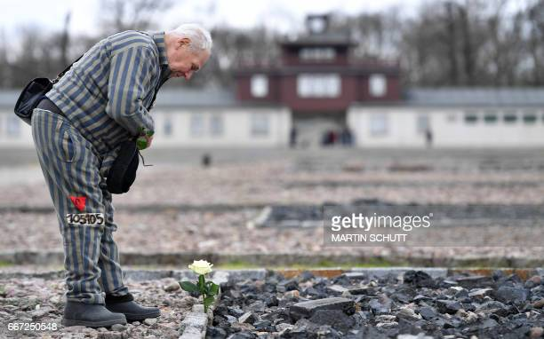 Ukrainian former prisoner Petro Mishchu pays his respects at the Buchenwald Nazi concentration camp in Weimar, eastern Germany on April 11 marking...