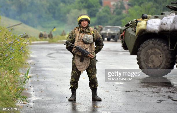 Ukrainian government soldier stands guard on July 7, 2014 in the eastern Ukrainian city of Slavyansk. Retreating pro-Russian insurgents dug in on...