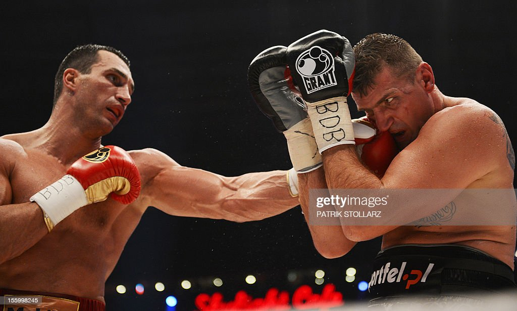 Ukrainian heavyweight boxing world champion Wladimir Klitschko (L) fights with Polish challenger Mariusz Wach in the IBF, IBO, WBO and WBA title bout at the O2 arena on November 10, 2012 in the nothern German city of Hamburg.