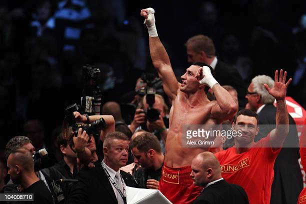 Ukrainian heavyweight champion Wladimir Klitschko celebrates with his brother Vitali after knocking out challenger Samuel Peter of Nigeria during...