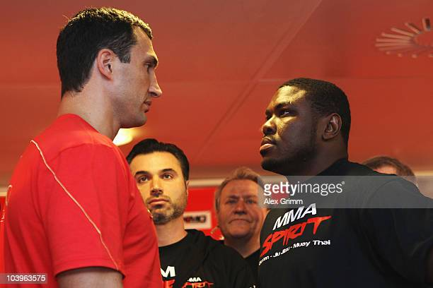 Ukrainian heavyweight champion Wladimir Klitschko poses with challenger Samuel Peter of Nigeria during the official weigh in at the local Karstadt...