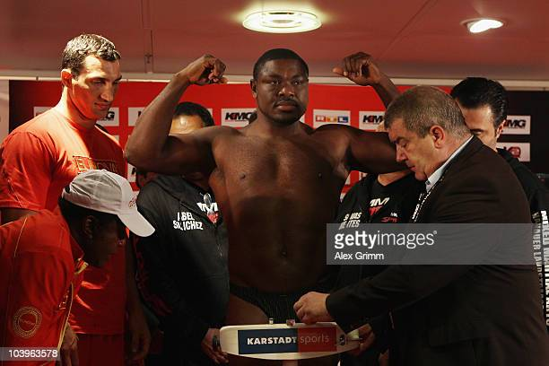 Ukrainian heavyweight champion Wladimir Klitschko watches challenger Samuel Peter of Nigeria during the official weigh in at the local Karstadt...
