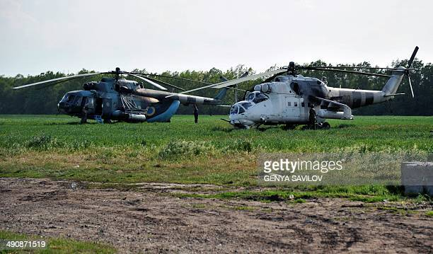 Ukrainian helicopters are parked near a checkpoint on the road near the eastern city of Izum Donetsk region on May 15 2014 Just 10 days before a key...