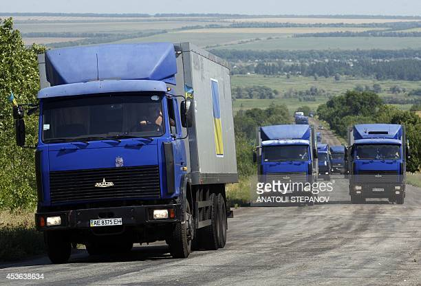 A Ukrainian humanitarian convoy rides near the eastern Ukrainian city of Severodonetsk Lugansk region on August 15 2014 A spokesman for the Ukrainian...