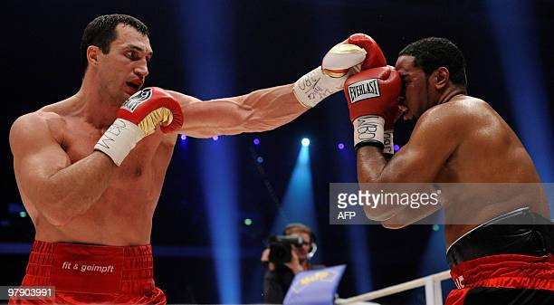 Ukrainian IBF WBO and IBO heavyweight champion Vladimir Klitschko lands a left on US challenger Eddie Chambers during their heavyweight world...