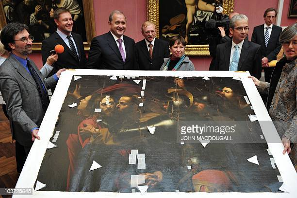 Ukrainian Interior Minister Anatoliy Mohilev and Berlin senator for Justice Gisela von der Aue pose next to the painting 'The Taking of Christ' by...
