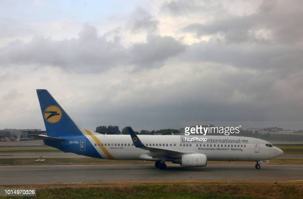 Ukrainian International Airlines Boeing 737-800 airplane preparing to take off from Amsterdam Airport Schiphol in Amsterdam, Netherlands.