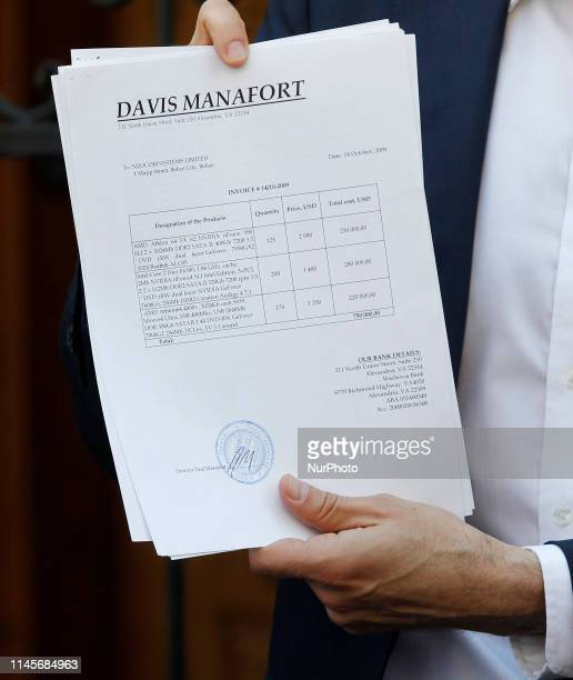 Ukrainian journalist and member of parliament Serhiy Leshchenko shows to journalists a document as he arrives to question to the General Prosecutor's...