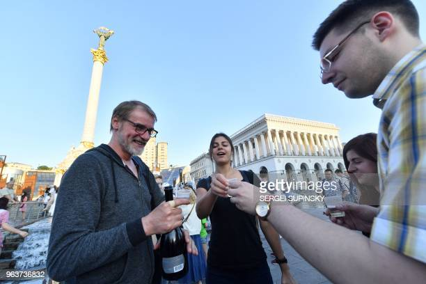 Ukrainian Journalists who originally rallied at Independence Square in Kiev to mourn antiKremlin journalist Arkady Babchenko celebrate after he...