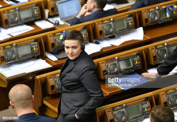 Ukrainian lawmaker Nadiya Savchenko attends a Parliament session in Kiev on March 15 2018 Nadiya Savchenko once hailed as a hero and a symbol of...