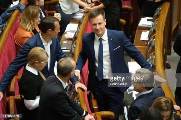 Ukrainian lawmaker Valentin Nalyvaichenko chats with colleagues, including Yulia Tymoshenko , during a session of the Verchovna Rada, the Ukrainian...