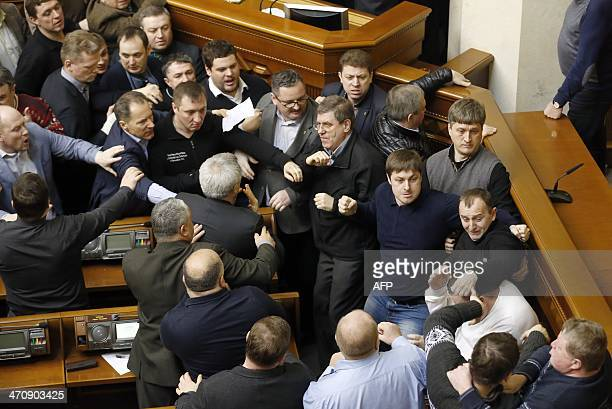 Ukrainian lawmakers clash during a Parliament session in Kiev on February 21 2014 Ukraine's embattled President Viktor Yanukovych said Friday he was...