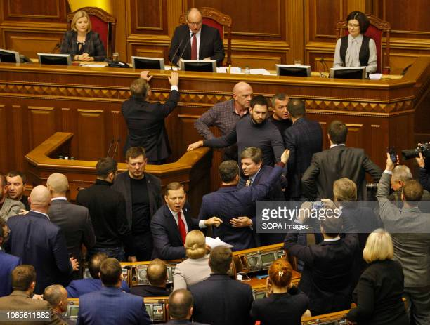 Ukrainian lawmakers seen during a Ukrainian Parliament session in Kiev The Ukrainian lawmakers voted to introduce martial law in regions of Ukraine...