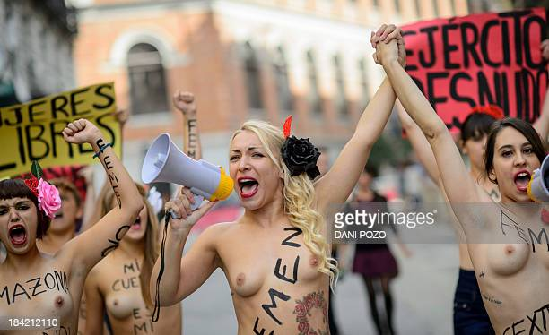 Ukrainian leader of feminist movement Femen Inna Shevchenko and Lara Alcazar leader of feminist movement Femen in Spain take part in a march in...