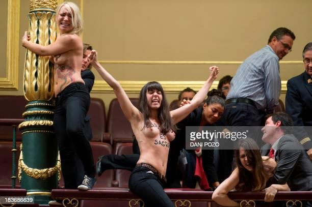 Ukrainian leader of feminist movement Femen Inna Shevchenko French leader of feminist movement Femen Pauline Hillier and Spanish leader of feminist...