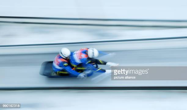 Ukrainian lugers Oleksandr Obolonchyk and Roman Zakharkiv in action at the starting line during the men's doubles event of the Luge World Cup 2018 in...