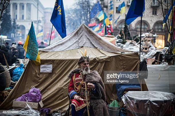 Ukrainian man with the traditional military uniform attend an antigovernment protests at capital Kiev's Independence Square in Ukraine on December 16...