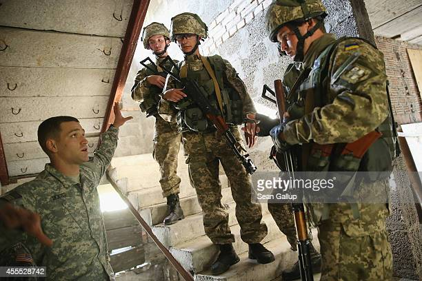 Ukrainian marines receive instruction in urban warfare techniques from a US military instructor on the second day of the 'Rapid Trident' bilateral...