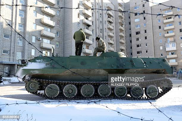 Ukrainian medical servicemen stand on an Armoured Personnel Carriers after they carried wounded servicemen to hospital in Ukrainecontrolled town of...