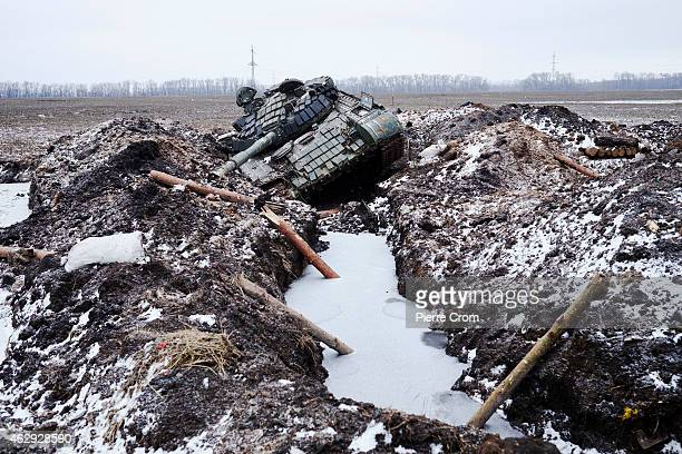 Ukrainian military lies in a ditch on February 7 2015 in Uglegorsk Ukraine According to ProRussian rebels control of Uglegorsk on the frontline near...