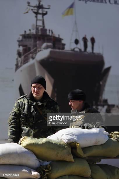 Ukrainian military personel stand inside a Ukrainian military base on March 17 2014 in Simferopol Ukraine Voters on the autonomous Ukrainian...