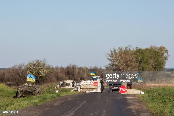 Ukrainian military personnel guard a check point on April 25 2014 near the town of Barvinkova Ukraine ProRussian activists have been occupying...