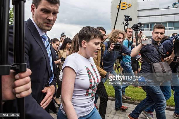 Ukrainian military pilot Nadiya Savchenko is greeted by President Petro Poroshenko of Ukraine upon her arrival at Kyiv Boryspil Airport on May 25...