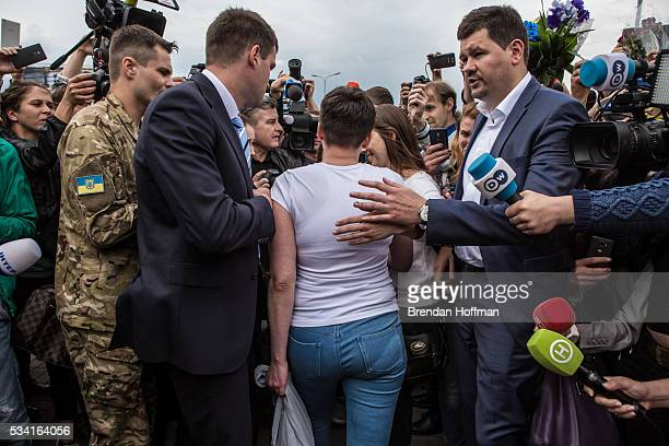 Ukrainian military pilot Nadiya Savchenko is surrounded by media upon her arrival at Kyiv Boryspil Airport on May 25 2016 in Boryspil Ukraine...