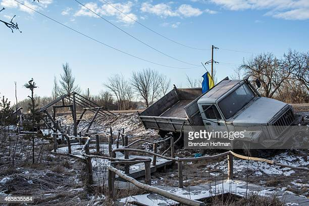 Ukrainian military truck lies in a ditch at the side of the road leading out of Debaltseve on February 19, 2015 in Artemivsk, Ukraine. Ukrainian...
