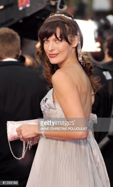 Ukrainian model and actress Milla Jovovich poses as she arrives to attend the screening of German director Wim Wenders' film 'The Palermo Shooting'...
