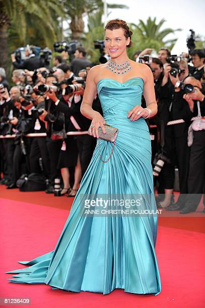 Ukrainian model and actress Milla Jovovich poses as she arrives to attend the Closing Ceremony of the 61st Cannes International Film Festival on May...