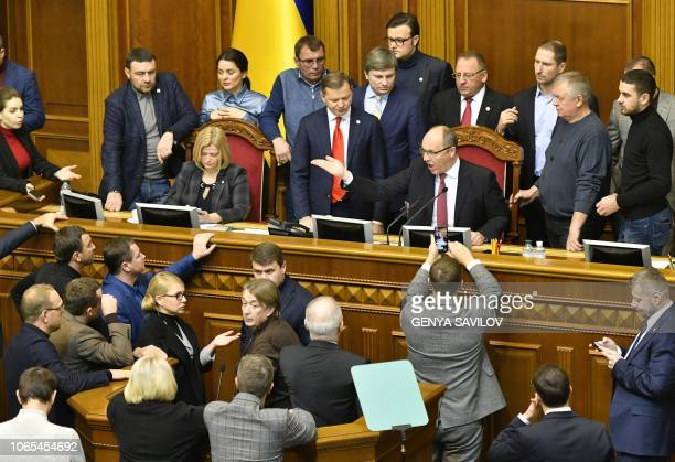 Ukrainian MPs argue with Parliament Speaker Andriy Parubiy before opening an emergency session at Parliament in Kiev on November 26 ahead of a...