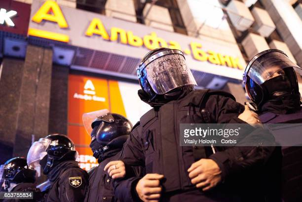 Ukrainian Nationalist protesters clash with police near a regional office of Russian 'Alfa' bank during a protest against Russian presence in Ukraine...