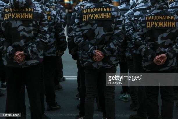 Ukrainian nationalists, the National Corps voluntary squad's members, march to mark the second anniversary of its creation downtown Kyiv, Ukraine, 02...